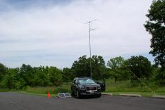 A view of the VHF station and solar panels against a partly cloudy sky - Photo by Fred Soop