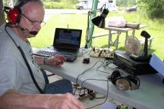 John KA9CAR checking to see that the 40m SSB station is shipshape - Photo by Fred Soop