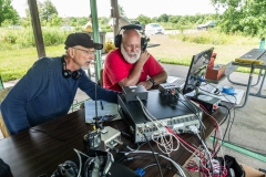Roger KF9D and Joel W9NXM discuss strategy - Photo by Ken Farver