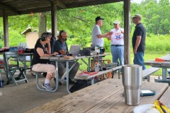 Bill (KD9WEW) operating the GOTA station while Loren (K3RFC) and Glenn (K9GLA)  discusses amateur radio with visitors