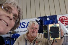 Phil W1EME and JoAnne K9JKM getting a selfie with the engineering model of the Fox-1 cubesat.