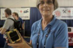 JoAnne K9KJM showing off a model of the Fox-1 cubesat at Xenia.